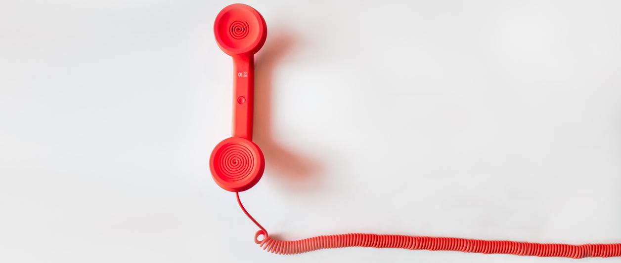 Closeup of red wired telephone