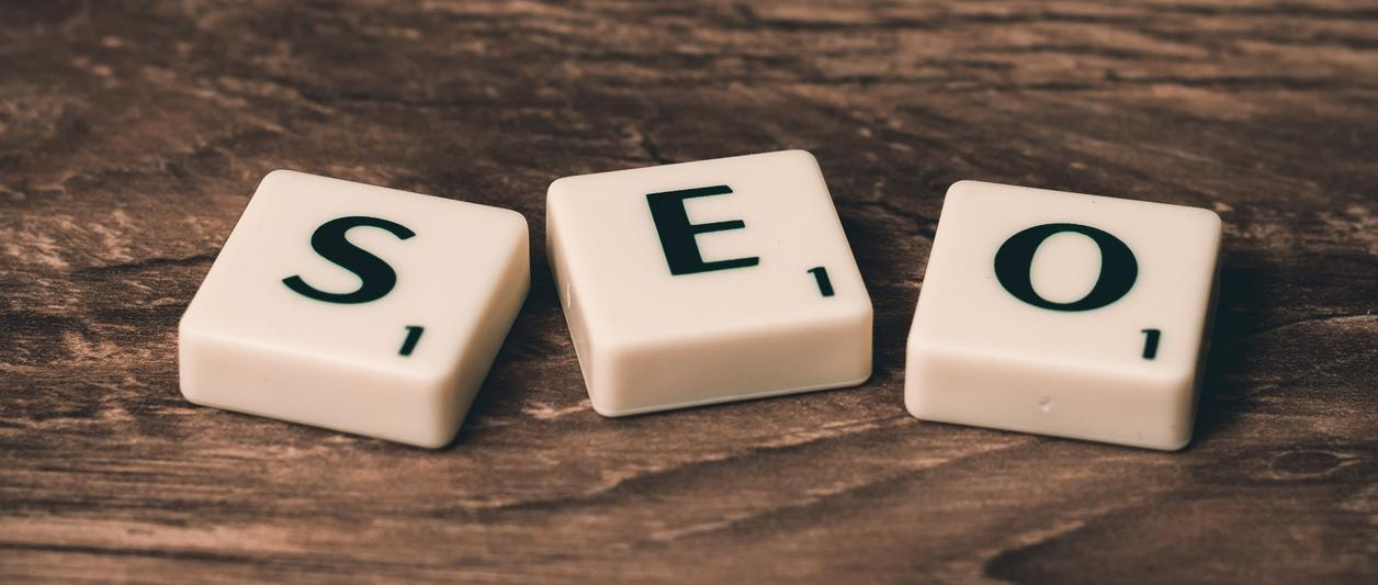 three Scrabble tiles spelling out S, E, O