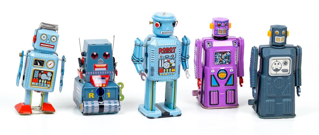 photo of row of toy robots in various colors